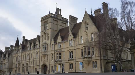 Low-Angle-Wide-Shot-of-Balliol-College-As-Pedestrians-Walk-Past