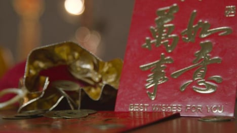 Sliding-Shot-of-Chinese-New-Year-Red-Envelopes-and-Coins