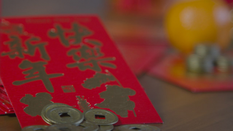 Sliding-Shot-Gliding-Over-Chinese-New-Year-Red-Pockets-and-Coins
