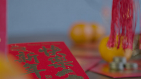 Sliding-Shot-Gliding-Over-Chinese-New-Year-Red-Packets-and-Coins