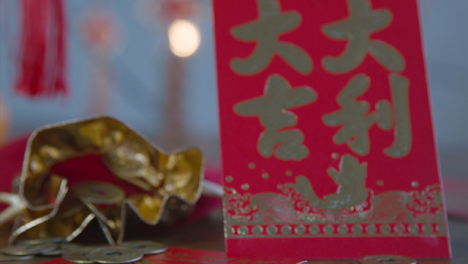 Sliding-Shot-Gliding-Over-Chinese-New-Year-Red-Envelopes-and-Coins