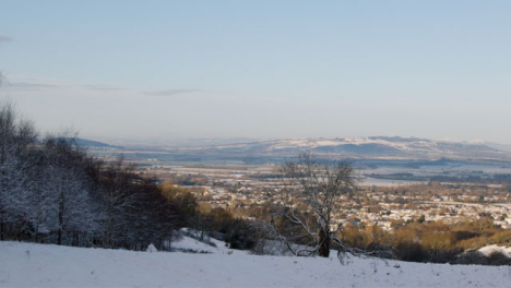 Panning-Shot-Overlooking-Snow-Covered-Hills-In-English-Countryside