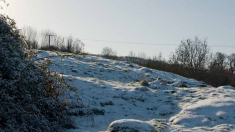 Tracking-Shot-of-Countryside-Field-Covered-In-Snow