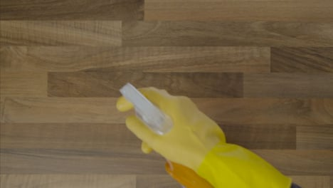 Top-Down-Shot-of-Male-Hands-Cleaning-a-Table-Surface-with-Anti-Bacterial-Spray-and-Cloth