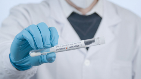 Close-Up-Shot-of-Medical-Professionals-Hand-Holding-a-Positive-COVID-Test-Tube-Result-
