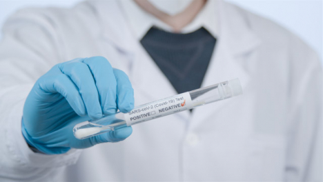 Close-Up-Shot-of-Medical-Professionals-Hand-Holding-a-Negative-COVID-Test-Tube-Result-