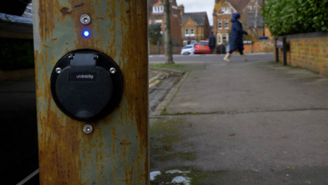Pedestal-Shot-Rising-Up-and-Looking-at-On-Street-Electric-Car-Charging-Point