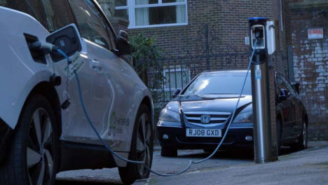 Low-Angle-Shot-of-Electric-Car-Charging-On-Street-