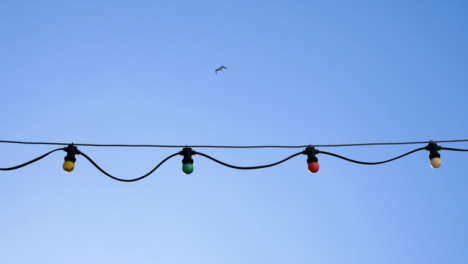 Handheld-Low-Angle-Shot-Looking-Up-at-Outdoor-Festive-Lights-