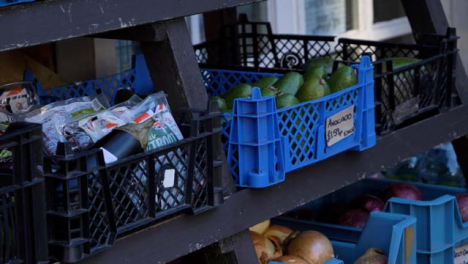 Handheld-Shot-of-Grocery-Stores-Outdoor-Fruit-and-Vegetable-Display