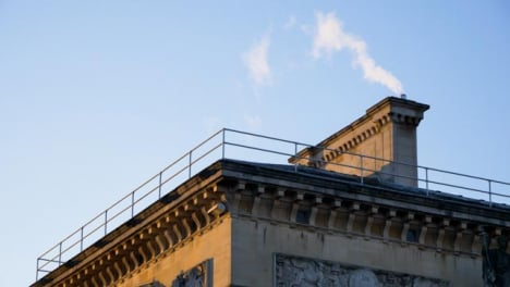 Low-Angle-Shot-Looking-Up-at-Smoke-Pouring-Out-of-Chimney-