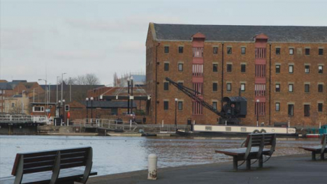 Tracking-Shot-Past-Wall-Revealing-Industrial-Docks-