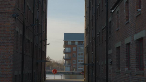Tilting-Shot-Looking-Up-at-Old-Warehouse-Buildings-In-Docks
