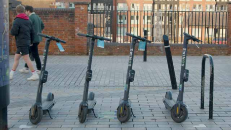 Medium-Shot-of-Stationary-Electric-Scooters