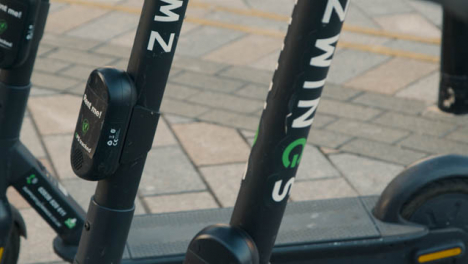 Pull-Focus-Close-Up-Shot-of-Stationary-Electric-Scooters