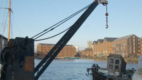 Tracking-Shot-Pulling-Away-from-Old-Industrial-Docks-Crane