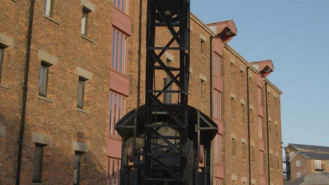 Tracking-Shot-Looking-Up-at-Arm-of-Old-Docks-Crane