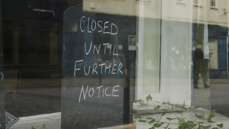 Close-Up-Shot-of-Closed-Until-Further-Notice-Sign-In-Shop-Window