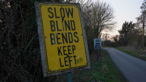 Pedestal-Shot-of-Road-Speed-Safety-Signs-On-Countryside-Road