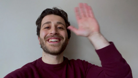 Young-University-Student-Waving-Talking-and-Waving-Directly-to-Camera