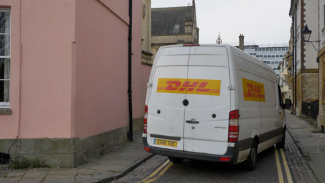 Tracking-Shot-of-Delivery-Van-Turning-Around-Corner-of-Old-Street