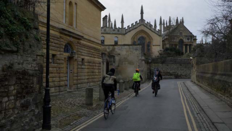 Tracking-Shot-Following-Cyclists-Down-Old-Oxford-Lane-
