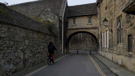 Tracking-Shot-Following-Cyclist-Down-Old-Oxford-Lane-