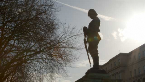 Tracking-Shot-Looking-Up-at-Silhouetted-Boer-War-Memorial