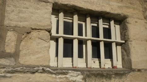 Close-Up-Shot-of-Old-Prison-Window-with-Bars-