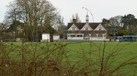 Long-Shot-of-Cricket-Pavilion-In-Park-