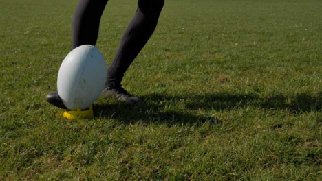 Medium-Shot-of-Rugby-Ball-Being-Kicked-from-Tee