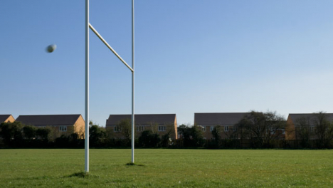 Wide-Shot-of-Rugby-Ball-Flying-Through-Rugby-Posts