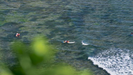 High-Angle-Long-Shot-of-People-In-Ocean-at-Echo-Beach