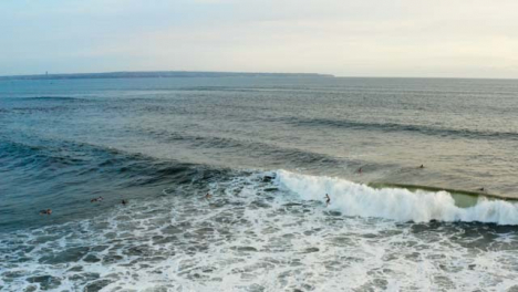 Drone-Shot-Following-a-Surfer-Riding-Wave-