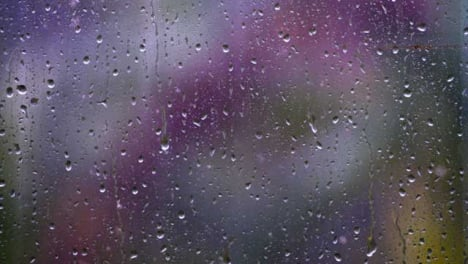 Close-Up-Shot-of-Rain-Droplets-On-Window