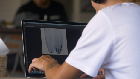 Long-Shot-of-Person-On-Laptop-Designing-Surfboard