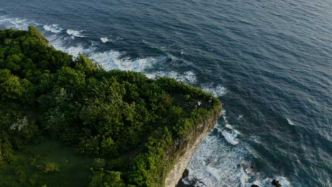 Drone-Shot-Orbiting-Group-of-People-Socialising-Near-a-Cliff-Edge-