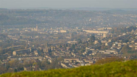 Pedestal-Shot-Rising-Up-Over-Small-Hill-and-Revealing-City-of-Bath