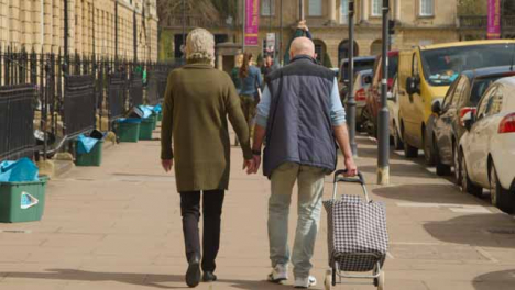 Tracking-Shot-Following-Senior-Couple-Down-Great-Pulteney-Street