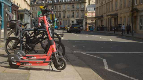 Medium-Shot-of-Stationary-Electric-Scooters-On-Road-Side