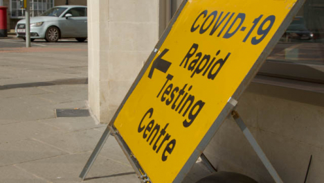 Panning-Shot-of-COVID-19-Test-Centre-Sign