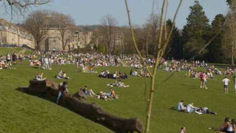Tracking-Shot-of-Pedestrians-On-Royal-Crescent-Green-
