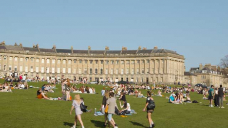Panning-Shot-of-a-Large-Number-of-Pedestrians-On-Royal-Crescent-Green