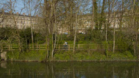 Wide-Shot-of-Cyclist-Riding-Along-River-Avon-Footpath