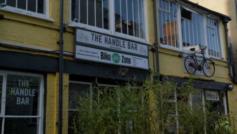 Tracking-Shot-of-The-Handle-Bar-Bicycle-Shop