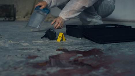 Wide-Shot-of-Forensic-Placing-Evidence-Tag-Next-to-High-Heel-at-Crime-Scene