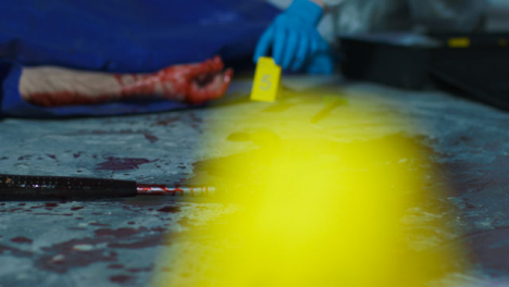Sliding-Close-Up-of-a-Bloody-Hammer-with-a-Forensic-Placing-Evidence-Tag-In-Background-