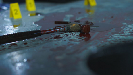 Pull-Focus-Shot-from-Shoe-to-Bloody-Hammer-at-Crime-Scene