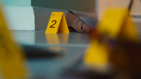 Pull-Focus-Shot-from-Shoe-to-Bloody-Broken-Bottle-at-a-Crime-Scene