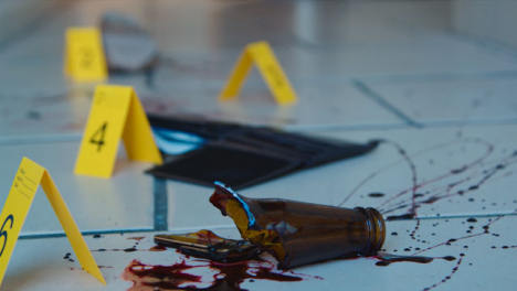 Pull-Focus-Shot-from-Bloody-Broken-Bottle-to-Shoe-at-Crime-Scene